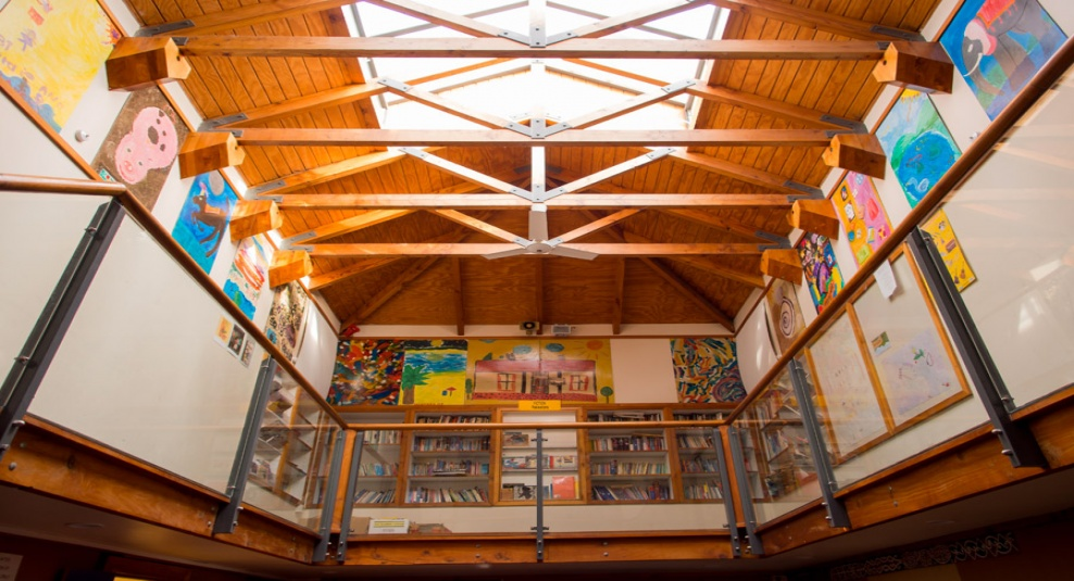 Tamariki School: The main hall atrium and library.